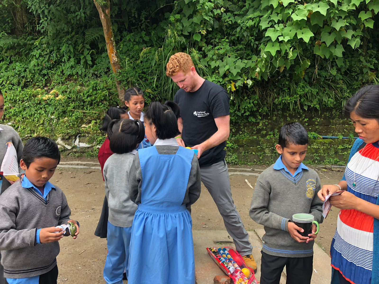 Adam Caulfield helps the children with their new toys.